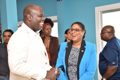 Minister of Public Telecommunications, Catherine Hughes and CEO of GTT Justin Nedd share a light moment at the re-opening of the company's store on Brickdam.