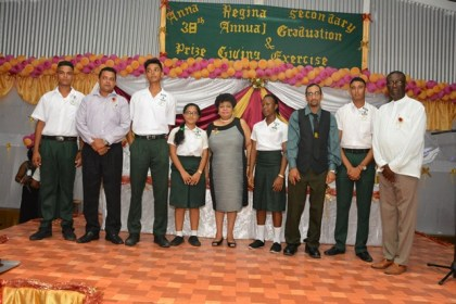 Minister of Social Cohesion, Ms. Amna Ally and Region Two Regional Executive Officer, Mr. Rupert Hopkinson (far right) pose with teachers, and the top five best performing students at the 2016 CSEC Examinations from  the Anna Regina Secondary School