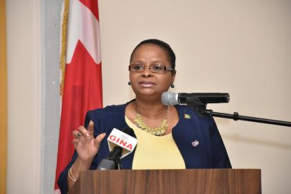 Minister of Social Protection, Volda Lawrence addressing  the forum in observance of International Day for the Elimination of Violence against Women and Women's Entrepreneurship Day