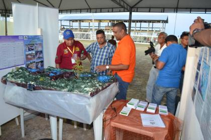 Minister of Indigenous Peoples Affairs Sydney Allicock in discussion with one of the Local exhibitors at the 16th Rupununi Expo