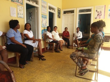 Staff of the Herstelling Health Centre and neighbouring health centres in discussion with a few of the Adolescent mothers.