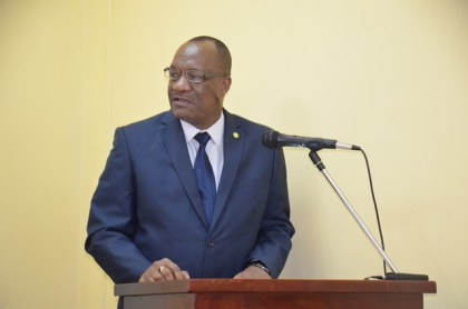 Minister of State, Mr. Joseph Harmon delivering an address at the meeting