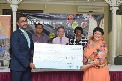 Richard Sammy, Managing Director of Republic Bank (Guyana) Limited, hands over the cheque to Andrea de Caires, President of the Tourism &Hospitality Association of Guyana (THAG). In the background from left-Mr. Indranauth Haralsingh Director of the Guyana Tourism Authority, Shaun McGrath, Executive Member of THAG and Michelle Johnson, Marketing and Communications Officer, Republic Bank.