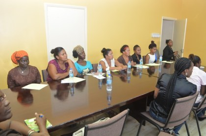 Some of the participants pay keen attention to First Lady, Mrs. Sandra Granger during her address at the workshop.