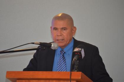 Minister of Public Health, Dr. George Norton, delivering remarks at the conference