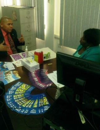Minister of Public Health Dr. George Norton engages with an HIV/AIDS counsellor/ tester, finding out all the information needed before he takes the HIV test.