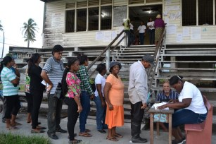 Voters line up on March 18 to cast their ballots in the country's long delayed Local Government Elections