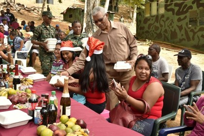 President Granger serves lunch to some of the nearby villagers who were invited to the annual Christmas lunch today at Location Eteringbang.