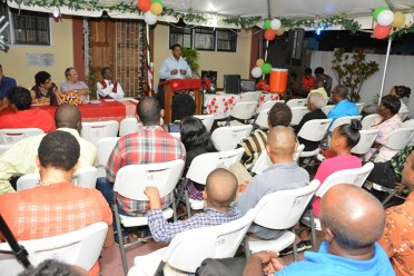 Members of the audience listen to the testimonial by Mr. Parmeswar Persaud, who has been drug free for five years and seven months