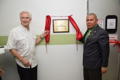 Dr. Wayne Warnica, Co-Director, GPACC Programme, University of Calgary and Dr. George Norton, Minister of Public Health unveil the plaque to commission the Cardiac Intensive Care Unit at the Georgetown Public Hospital Corporation