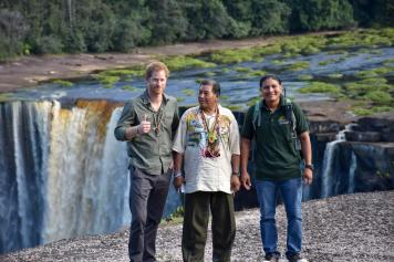 Prince Harry, with Minister of Indigenous Peoples' Affairs, Sydney Allicock and tour guide at the Majestic Kaieteur Falls.
