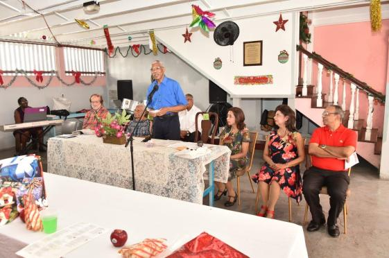 President David Granger delivering remarks at the Dharm Shala's annual Christmas luncheon. Also at the head table are from right- Executive Member of the Board of the Dharm Shala, Mr. Edward Boyer, Ms. Kella Ramsaroop, Ms. Pamela Ramsaroop, Ms. Sheila George and Father Thurston Riehl