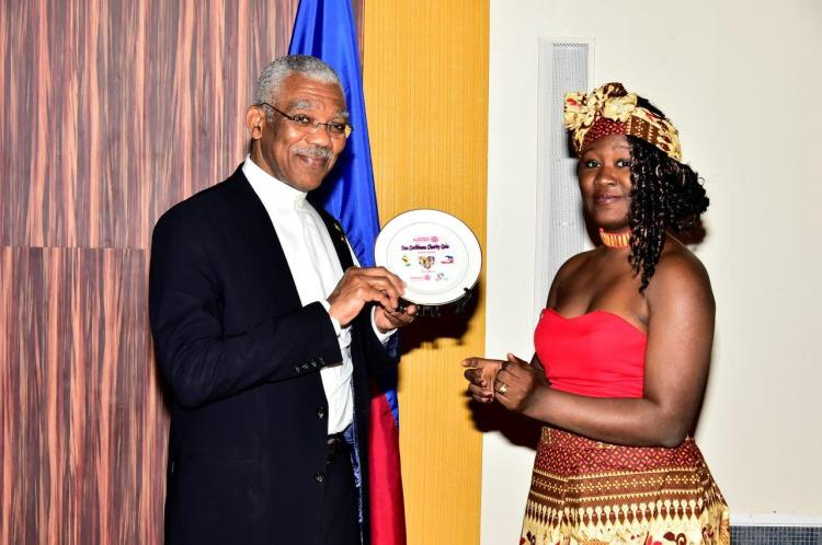 President David Granger received a special plaque from Ms. Noelle Plass as a token of appreciation for his attendance at the Gala