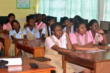 Students of the New Amsterdam Multilateral School pay rapt attention to the presentation by the volunteers of the Caribbean Youth Environment Network (CYEN)