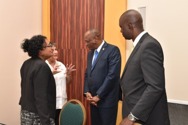 Minister of State, Mr. Joseph Harmon interacting with Commissioner of the Guyana Lands and Surveys Commission, Mr. Trevor Benn, Marine Conservation Activist, Mrs. Annette Arjoon- Martins and another participant