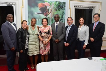 First Lady, Mrs. Sandra Granger is flanked by, from left to right: Mr. Douglas Brooks, Ms. Clarisa Castro, Dr. Donna Christensen, Mr. Clifford Samuel, Mr. Barry Featherman, Ms. Elizabeth Murray and Mr. Rafael Campos, all of Gilead Sciences Incorporated