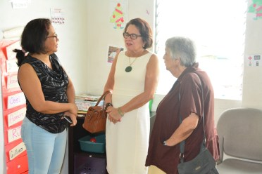 First Lady, Mrs. Sandra Granger (centre) and Dr. Suraiya Ismail, Chairperson of the Step by Step Foundation interact with Ms. Deborah Seebarran, whose son is enrolled at the school