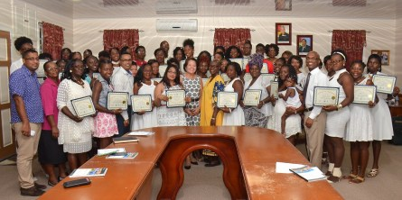 First Lady Mrs. Sandra Granger is flanked by successful participants of the Self-Reliance and Success in Business workshop, Deputy Regional executive officer of Region-Five, Regional Officials and Facilitators of Interweave Solutions Incorporated