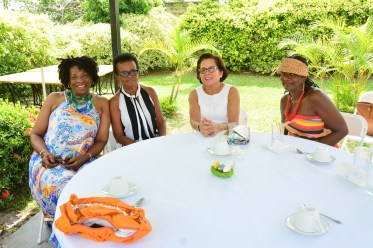 First Lady, Mrs. Sandra Granger is flanked by, from left to right, Ms. Yvonne Smith, of the Office of the First Lady, Ms. Pat Coates, and Ms. Patrice LaFleur, Resident Representative of the United Nations Population Fund at the WAD Easter Hat Show and Brunch