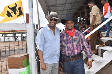 Minister Harmon shares a photo opportunity with one of the vaqueros at the Rodeo yesterday in Lethem