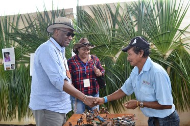 Minister Harmon greeting vendors at the Rupununi Rodeo, during a walkabout yesterday