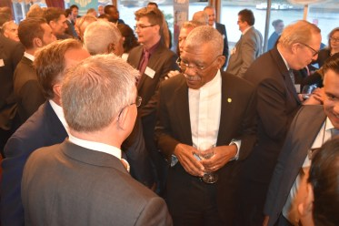 President David Granger interacting with guests at the Caribbean Council's House of Lords Annual Reception in the United Kingdom.