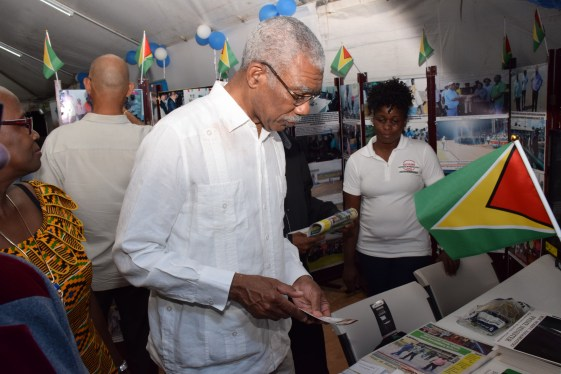 President David Granger visiting the Government Information Agency's (GINA) booth at the West Berbice Expo and Trade Fair