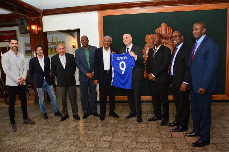 President David Granger received a personalised football jersey from President of the Fédération Internationale de Football Association (FIFA), Mr. Gianni Infantino. In photo from left: Mr. Juan Angel, Mr. Pablo Aldao, Minister of Social Cohesion, Dr. George Norton, Minister of State, Mr. Joseph Harmon, President Granger, Mr. Gianni Infantino, President of the Guyana Football Federation, Mr. Wayne Forde, Second Vice President, Mr. Rawlston Adams and First Vice President, Brigadier (Ret) Bruce Lovell
