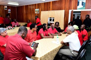 President David Granger and his delegation chatting with President of the GTUC, Ms. Coretta MacDonald who is flanked by Attorney General, Mr. Basil Williams and Minister within the Ministry of Social Protection with responsibility for Labour, Mr. Keith Scott