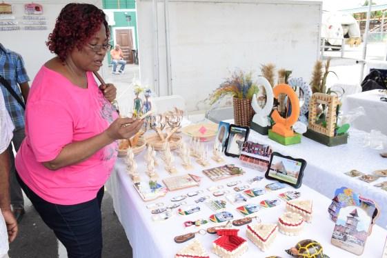 A customer viewing a tourism craft piece