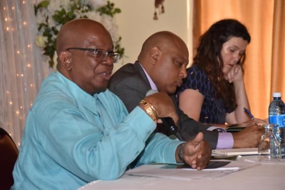 Minister of Finance Winston Jordan interacting with stakeholders at the two day Oil and Gas Sector Seminar at the De' Impeccable Banquet Hall