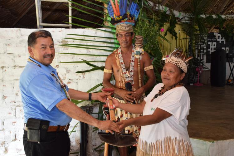 A resident of Shulinab receiving the equipment from Minister of Indigenous Peoples' Affairs, Sydney Allicock in the presence of Toshao Nicholas Fredericks