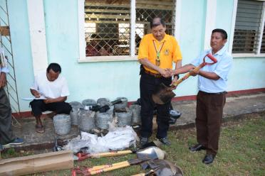 Toshao of Nappi, Walter Henry receiving the equipment from Minister of Indigenous Peoples' Affairs, Sydney Allicock