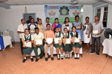 Representatives of Zeeburg Secondary School, West Demerara Secondary School and Saraswati Vidya Niketan (SVN) with the region's top Caribbean Secondary Education Certificate (CSEC) and Caribbean Advanced Proficiency Examination (CAPE) students