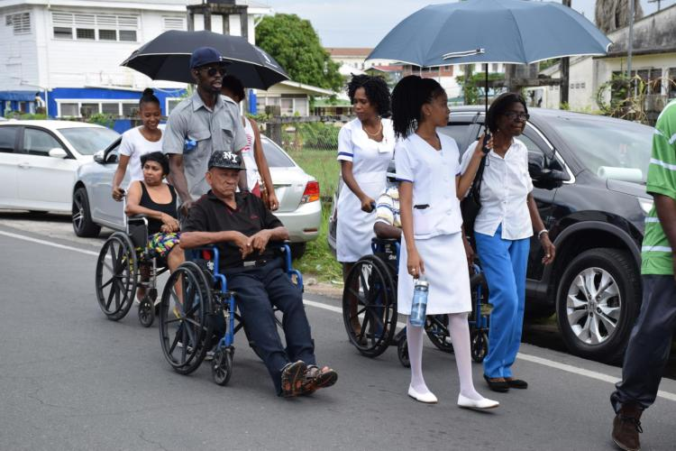 Some of the residents of Palms Geriatric Institution marching determinedly with the others
