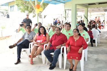 (Seated from left to right) Member of Parliament Charandass Persaud, Regional Executive Officer (REO) Kim Williams Stephen, Prime Minister Moses Nagamotoo and his wife Mrs. Sita Nagamootoo. Seated behind are members of the Chinese Medical Team