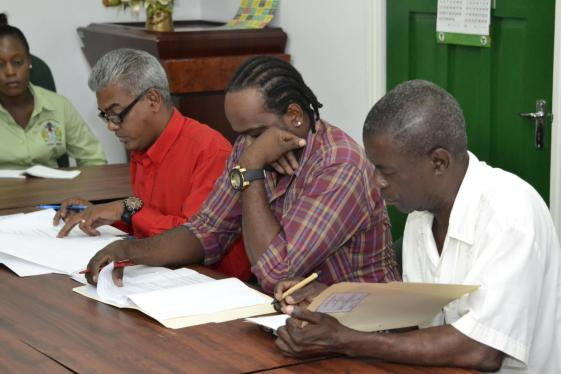 Representatives of the Guyana Power and Light (GPL) management and executive members of National Association of Agricultural, Commercial and Industrial Employees (NAACIE) peruses and signs off the contract entailing the salary increases