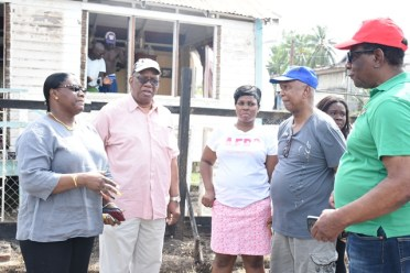 Minister Jordan and Minister Broomes engaging some of the fire victims