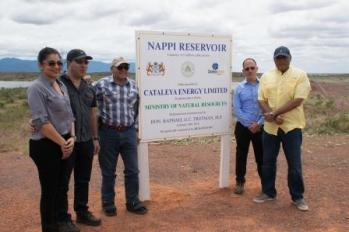 Minister of Natural Resources, Raphael Trotman (extreme right) and Minister of Indigenous Peoples Affairs, Sydney Allicock (in striped shirt) with representatives of Cataleya Energy Limited at the dedication site of the reservoir