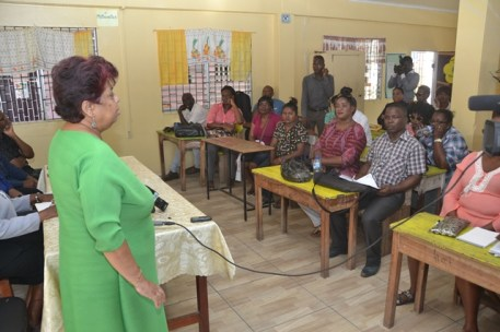 Minister of Social Protection, Amna Ally addressing the fire victims at the Plaisance Secondary School