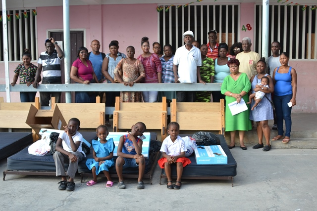 Minister of Social Protection, Amna Ally and the fire victims at the Plaisance Secondary School