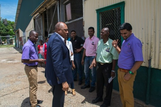 Minister of Natural Resources Raphael Trotman in talks with School Programme Coordinator of GTC Zamin Ally