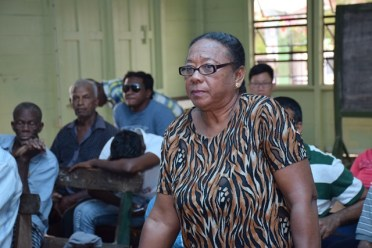 Resident of Canal Number One, Iola Chetnaraine raising her concern at the meeting