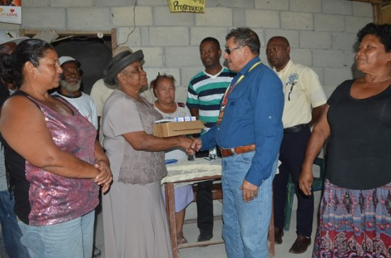 Minister of Indigenous Peoples Affairs, Sydney Allicock, handing over the equipment to Chairperson of the Community Development Council (CDC), Ruby Bakker