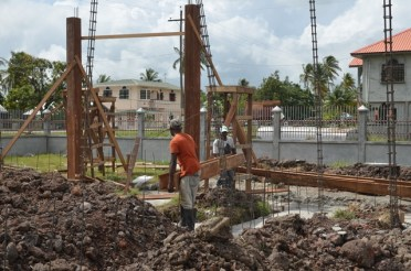 Workers constructing the new school building