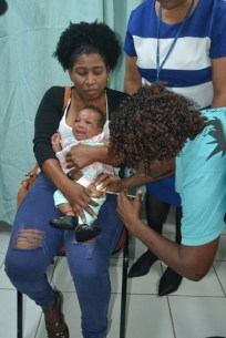 A baby being vaccinated after the launch of vaccination week in Guyana