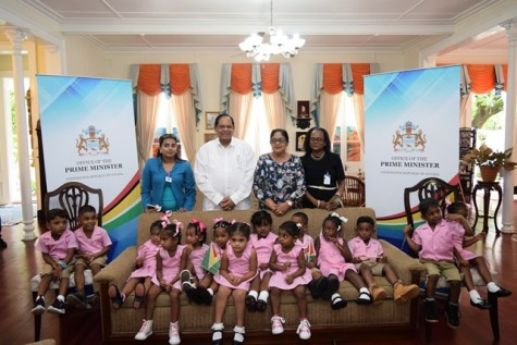 Prime Minister, Hon. Moses Nagamootoo and Mrs. Sita Nagamootoo with Headmistress Emella Crandon, a teacher and students of the Little Angels Play Group.
