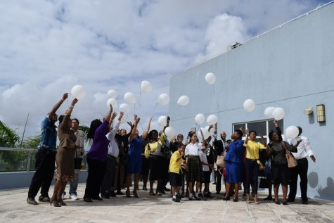 The symbolic release of white balloons on terrace