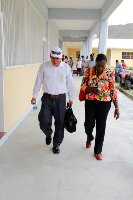 Minister Norton and Minister Henry walking the school grounds