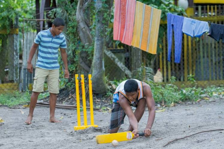 Relon (batting) and Roell (bowling) enjoying a game of blind cricket in their yard